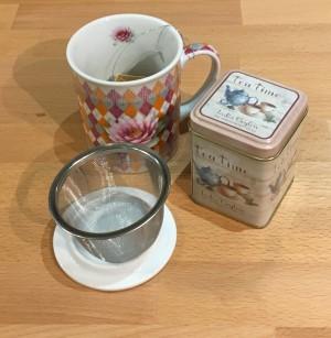 Colourful Art Deco Cup and Tea Tin
